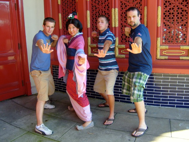 Posing like warriors with Mulan and our friend David